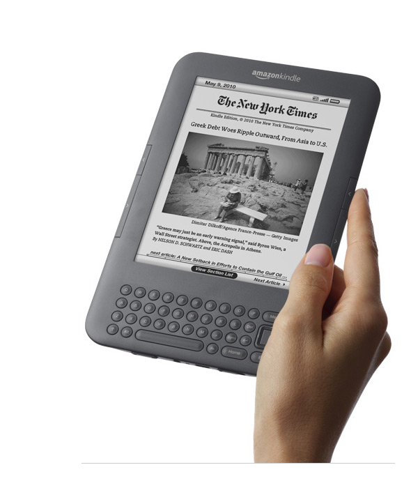 Large photo of Amazon Kindle 3 in female hand - Gray
