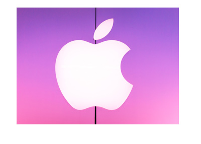 Apple - Real life company logo on purple-pink background.  Store front.  Year is 2018.