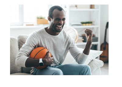 The basketball fan cheering at the news of the potential of legalizing of sports betting in the United States.