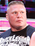 Photo of WWF and UFC superstar - Brock Lesnar - LCD screen in the background - Blank stare