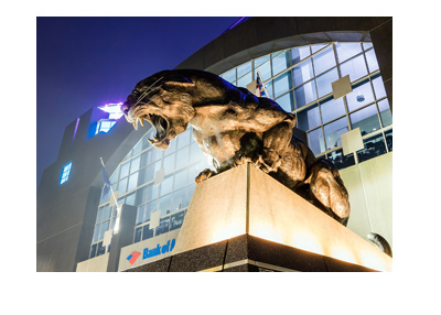 Carolina Panthers stadium front.  Roaring panther statue. Night shot.