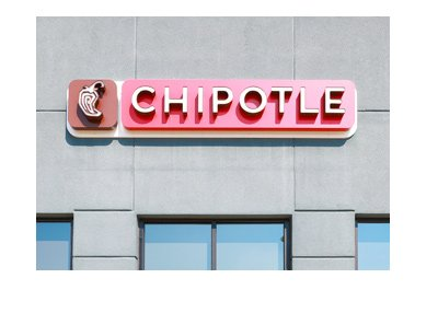The Chipotle store front.  Logo on concrete building.  Year is 2017.