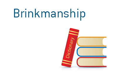 Dictionary entry for the term Brinkmanship when it comes to politics and finance