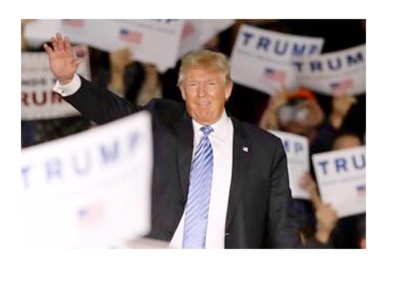 Donald Trump among his supporters.  Hand raised in the air. - December 2015
