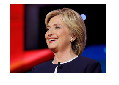 A photo of Hillary Clinton with a big smile on her face.  What is her next move?
