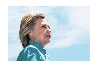 Hillary Clinton 2016 campaign photo.  Blue dress, looking up into the blue sky.