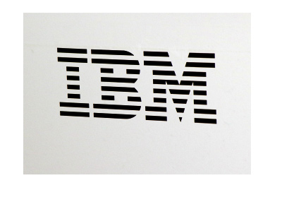 Photograph of the IBM company sign.  Black lettering on white background.  Year is 2017.