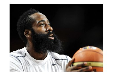 Basketball player, James Harden, taking a shot.  Full focus.