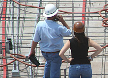 -- Construction site - Man and Woman workers --