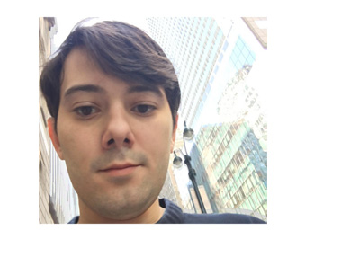 Martin Shkreli selfie photo with highrises in the background. Twitter.