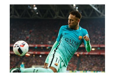 Neymar, wearing the barca away shirt, is showing skills with the ball.  Transfer to PSG is pending.