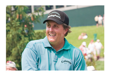 Photo of golfer Phil Mickelson on the golf course.  Big smile on his face.