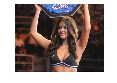 The beautiful UFC Octagon Girl holding up a round sign.