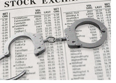 handcuffs on top of a stock market data chart