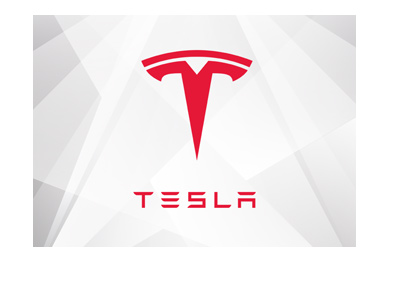Tesla company logo - Year is 2018 - Red on white  - stylized angular background.