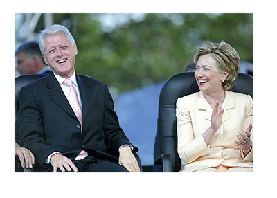 The Clintons having a laugh in 2005.  Sitting in chairs