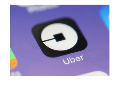 Uber app pictured on a smartphone, surrounded by other apps.