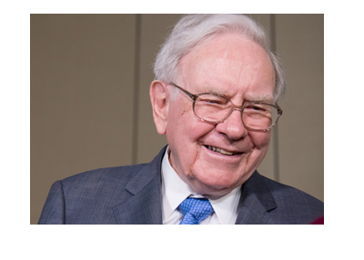 Warren Buffett photographed with a big smile on his face.