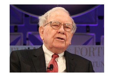 Warren Buffett is photographed during an interview.  Purple lighting is in the background.