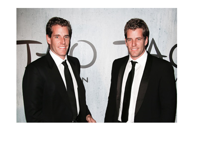 The Winklevoss twins dressed up for a night out.  Photographed wearing black suits and bow ties.